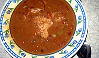 Pork with red kidney beans (frijoles colorados con carne de puerco).